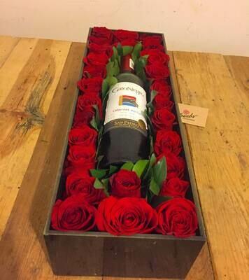 Caja de rosas con vino