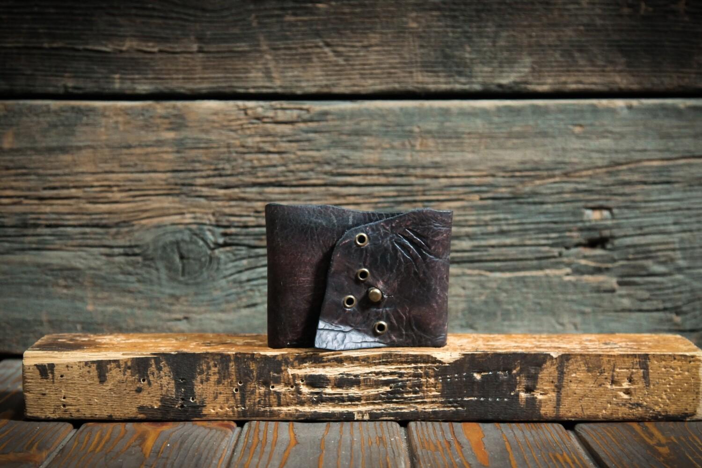 Кошелёк чёрно-коричневый цвета из сыромятной кожи