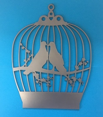 Kissing birds in a cage wall art