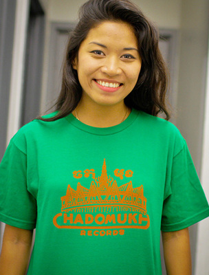 Green unisex shirt with '60s Cambodian record logo