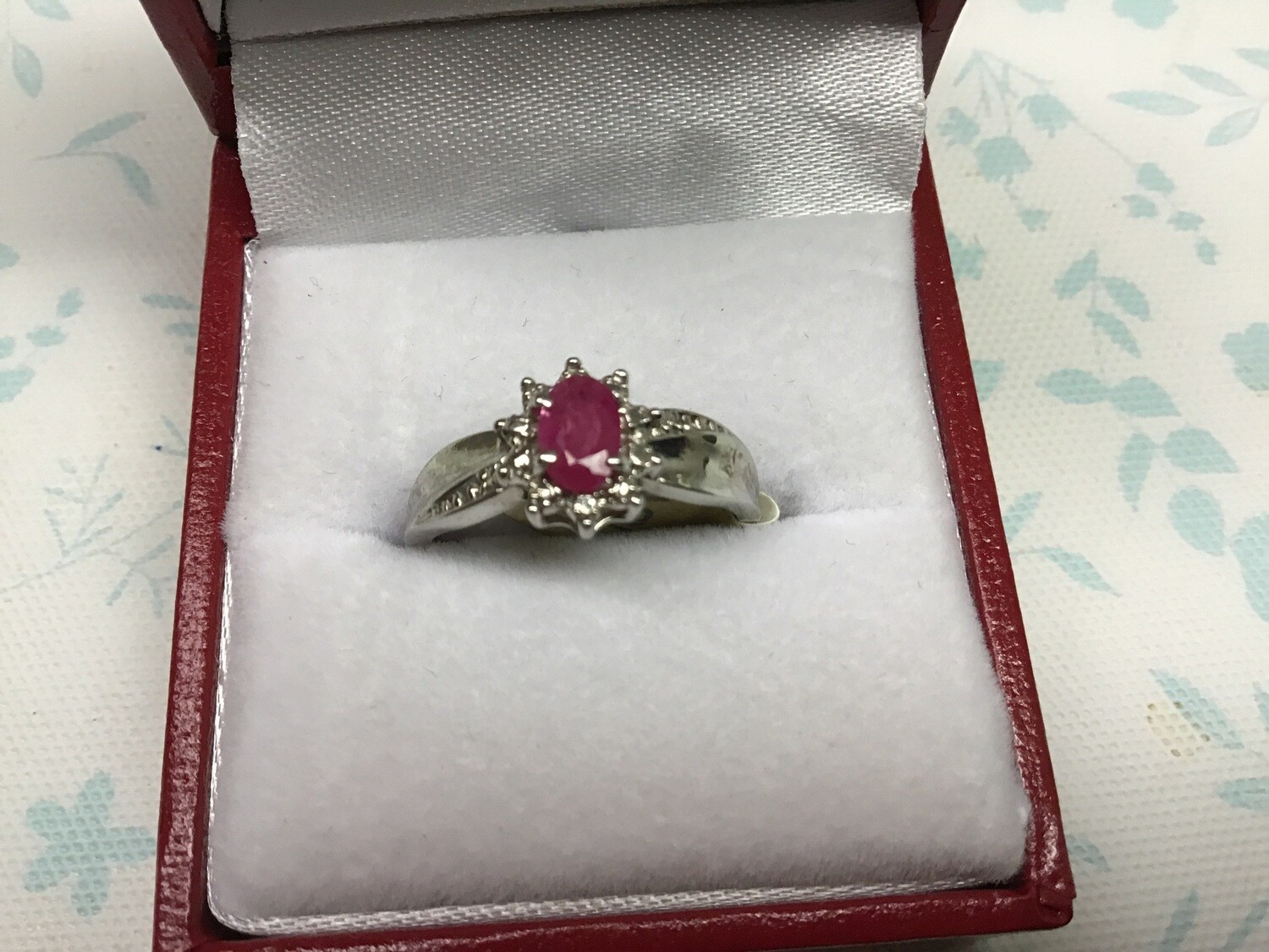 OVAL RUBY WITH DIAMONDS