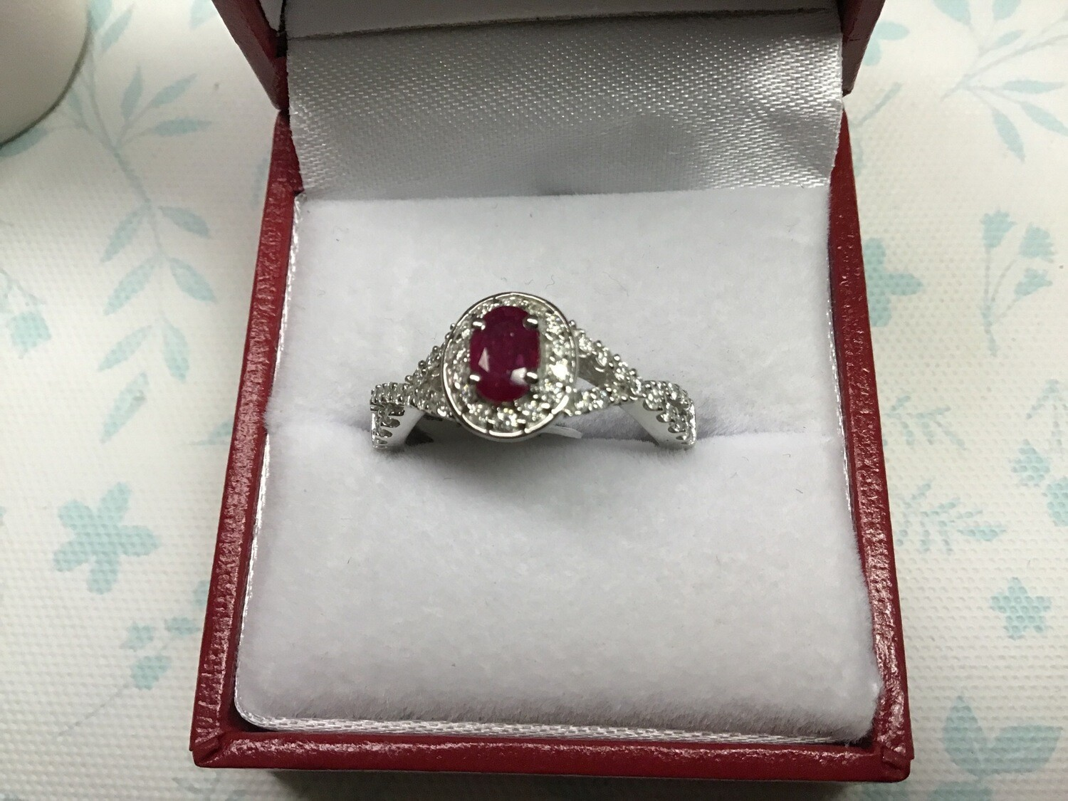 OVAL RUBY CRISSCROSS RING WITH DIAMONDS