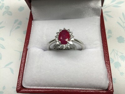 OVAL RUBY HALO RING WITH DIAMONDS