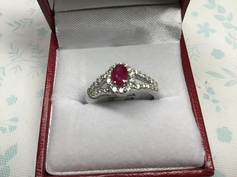 OVAL RUBY HALO SPLIT SHANK RING WITH DIAMONDS