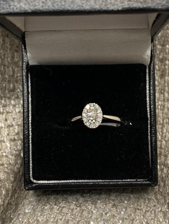 Oval Diamond Halo Engagement Ring