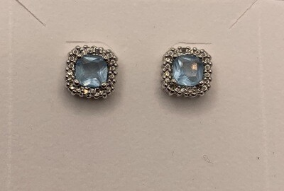 Light Blue Synthetic Birthstone With Genuine Diamond Halo