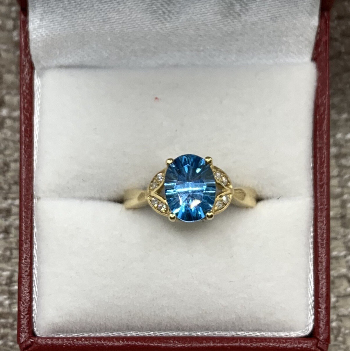 Oval Cut Blue Topaz With Diamond Accents
