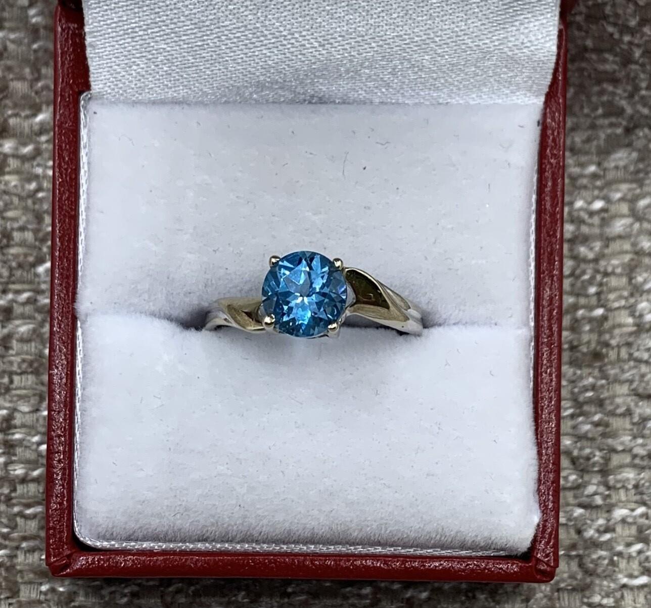 Round Blue Topaz Twist Shank Ring