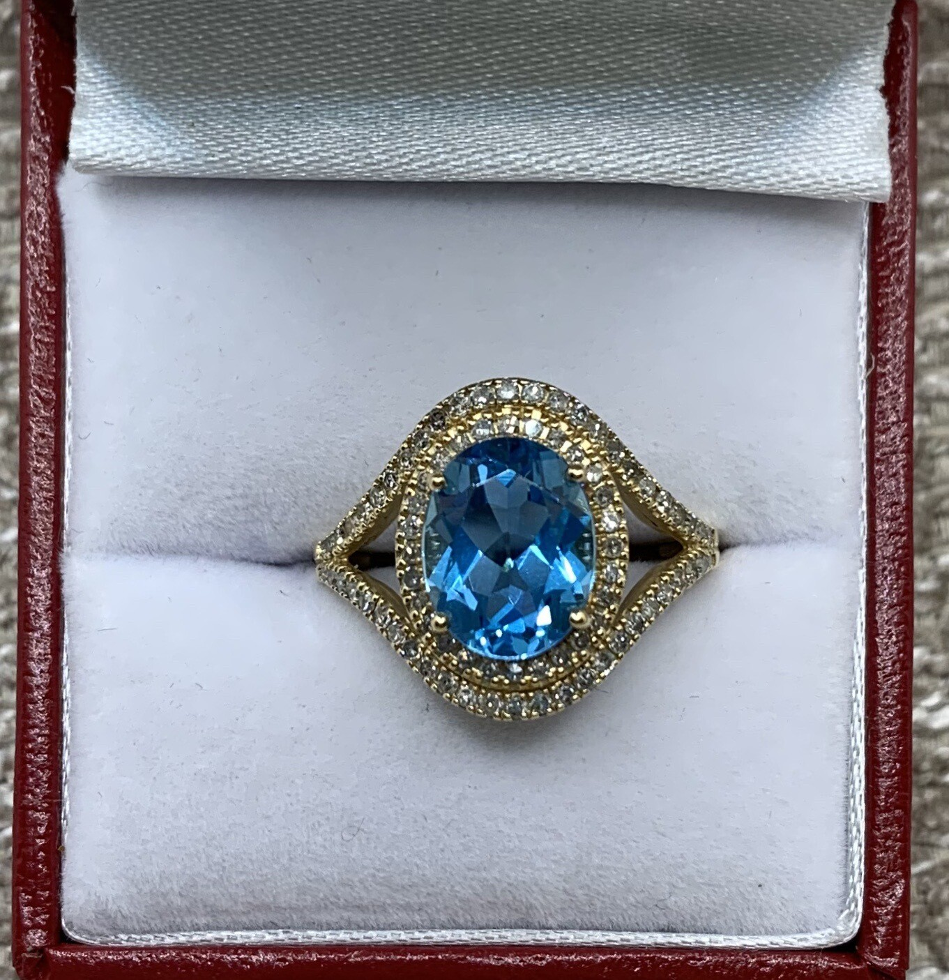 Stunning Oval Blue Topaz With Diamond Halo And Diamond Accent Band