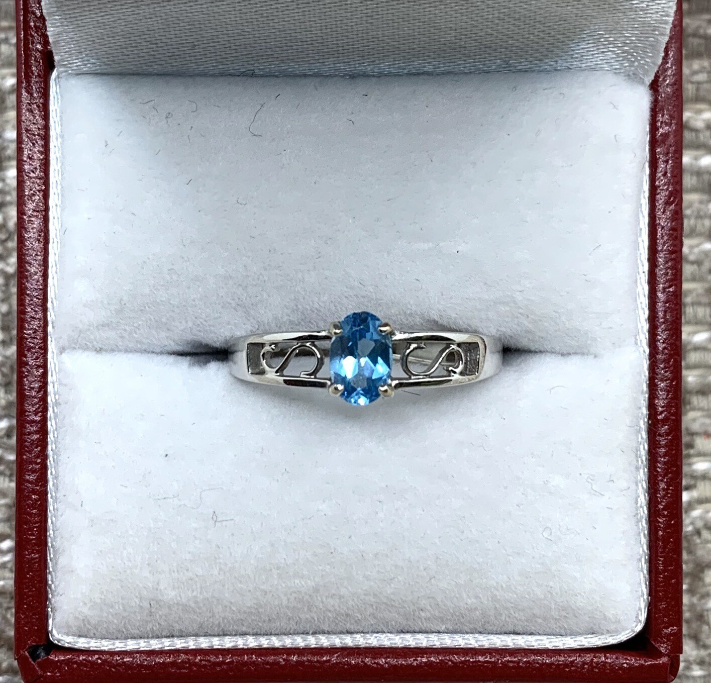 Oval Blue Topaz With Swirl Accent Band Ring