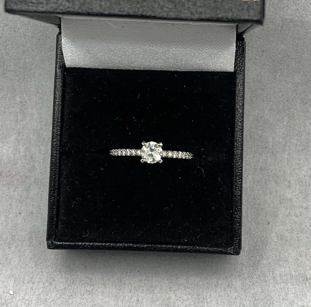 37 Pt Center Brilliant Diamond With 20 Pt Sides. SI2 H