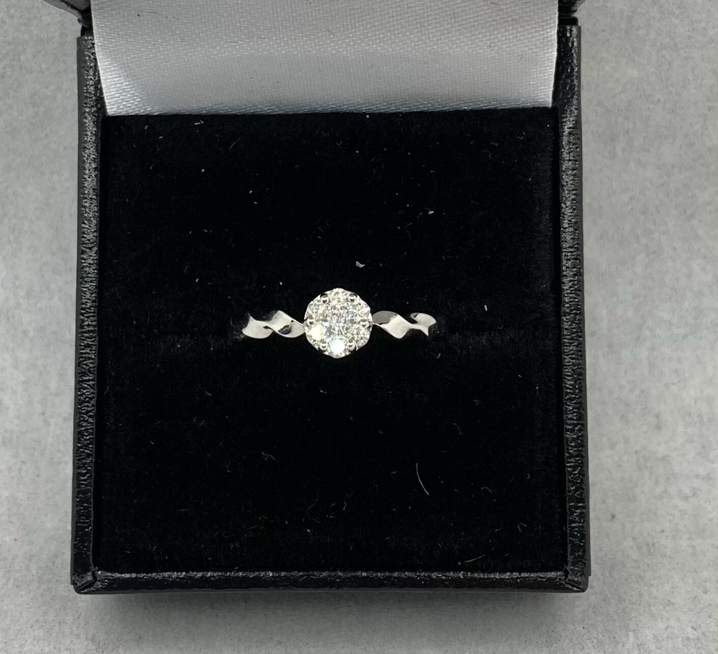 Round Cluster 25 Pt Total Weight Twisted Band Engagement Ring