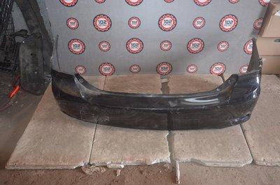 Задний бампер Toyota Corolla E151