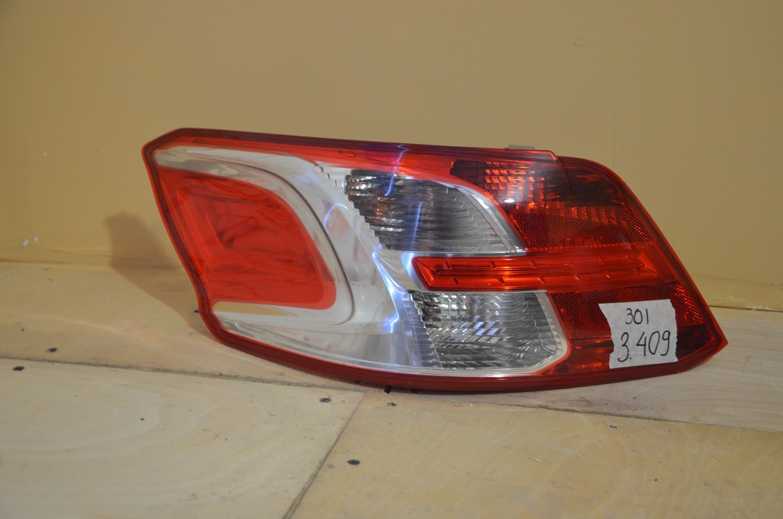 фонарь задний левый Peugeot 301 (2013--)