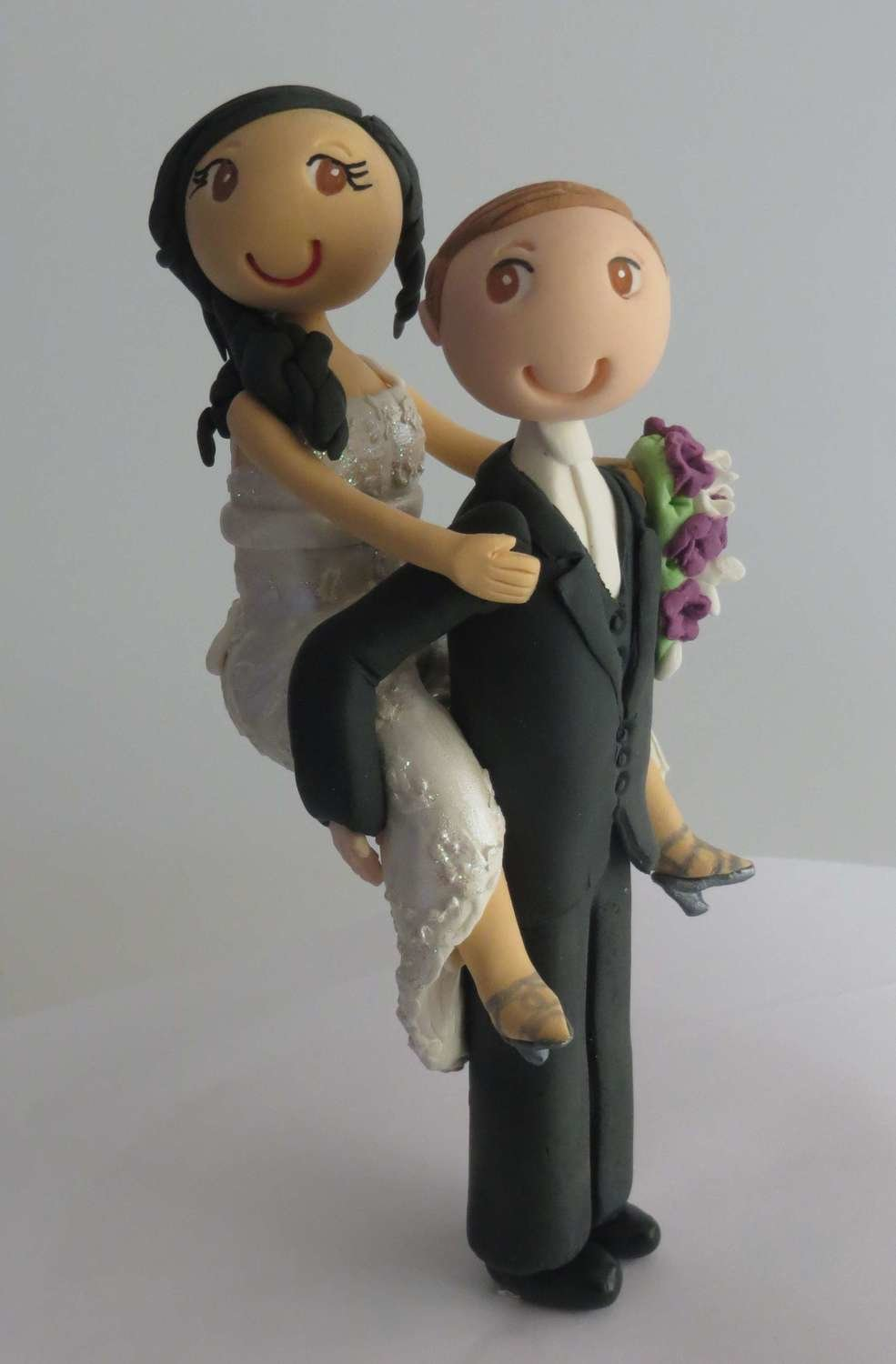 Piggybacking  Bride & Groom on round base board