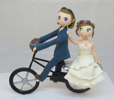 Bride & Groom on Bicycle on round base board