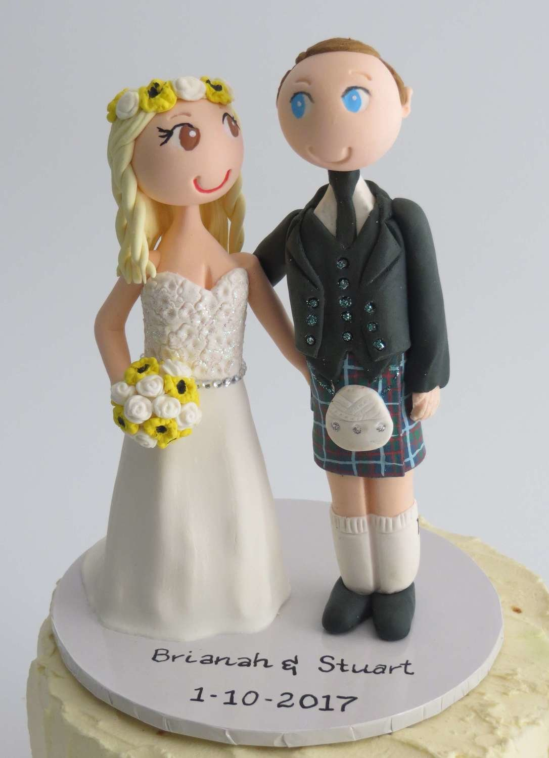 Scottish  Couple -on round base board