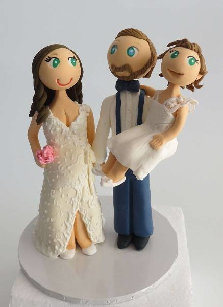 Standing Bride & Groom with 1 child on round base board
