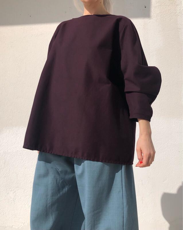 Blusa morbida con manica stondata