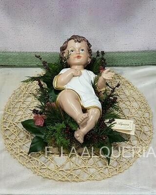 Niño Jesús en cama navideña