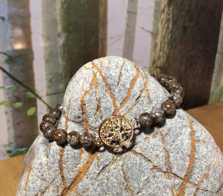 «Reconnection à la terre mère»/ Bois fossilisé, symbole arbre de vie.