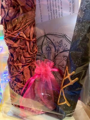 Kit Rituel Imbolc : grande sauge sang de dragon, bougie brune avec sigil d'imbolc, grenat avec graines de plantes médicinales, mandala et une feuille d'accompagnement qui explique le rituel
