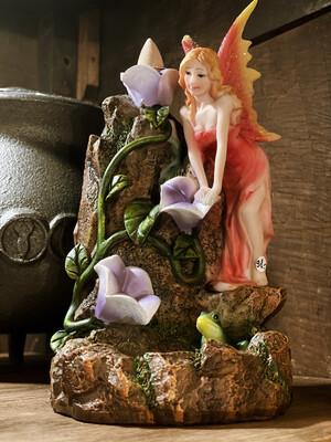 Diffuseur d'encens fée pour cônes d'encens à reflux, avec un paquet d'encens.