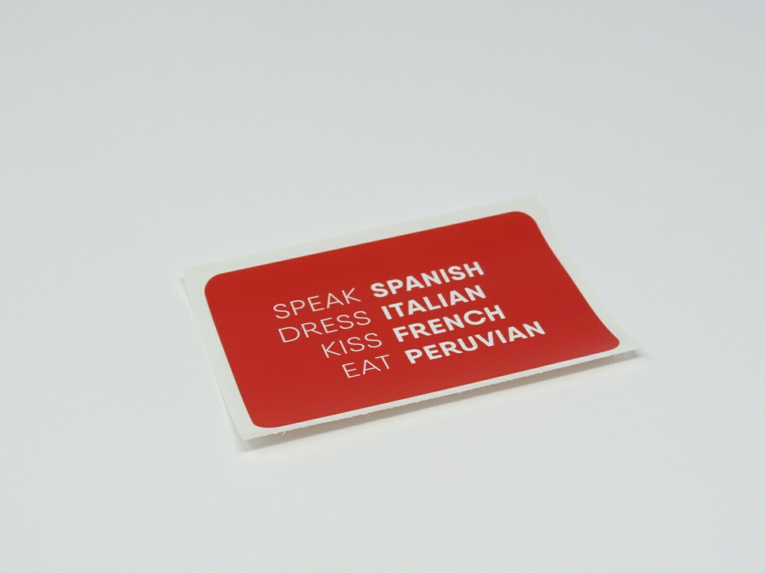Speak Spanish, Dress Italian, Kiss French, Eat Peruvian Sticker