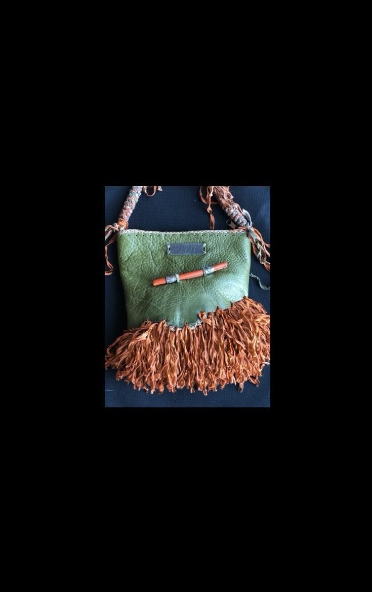 Green Leather Handbag with fiery orange fringe