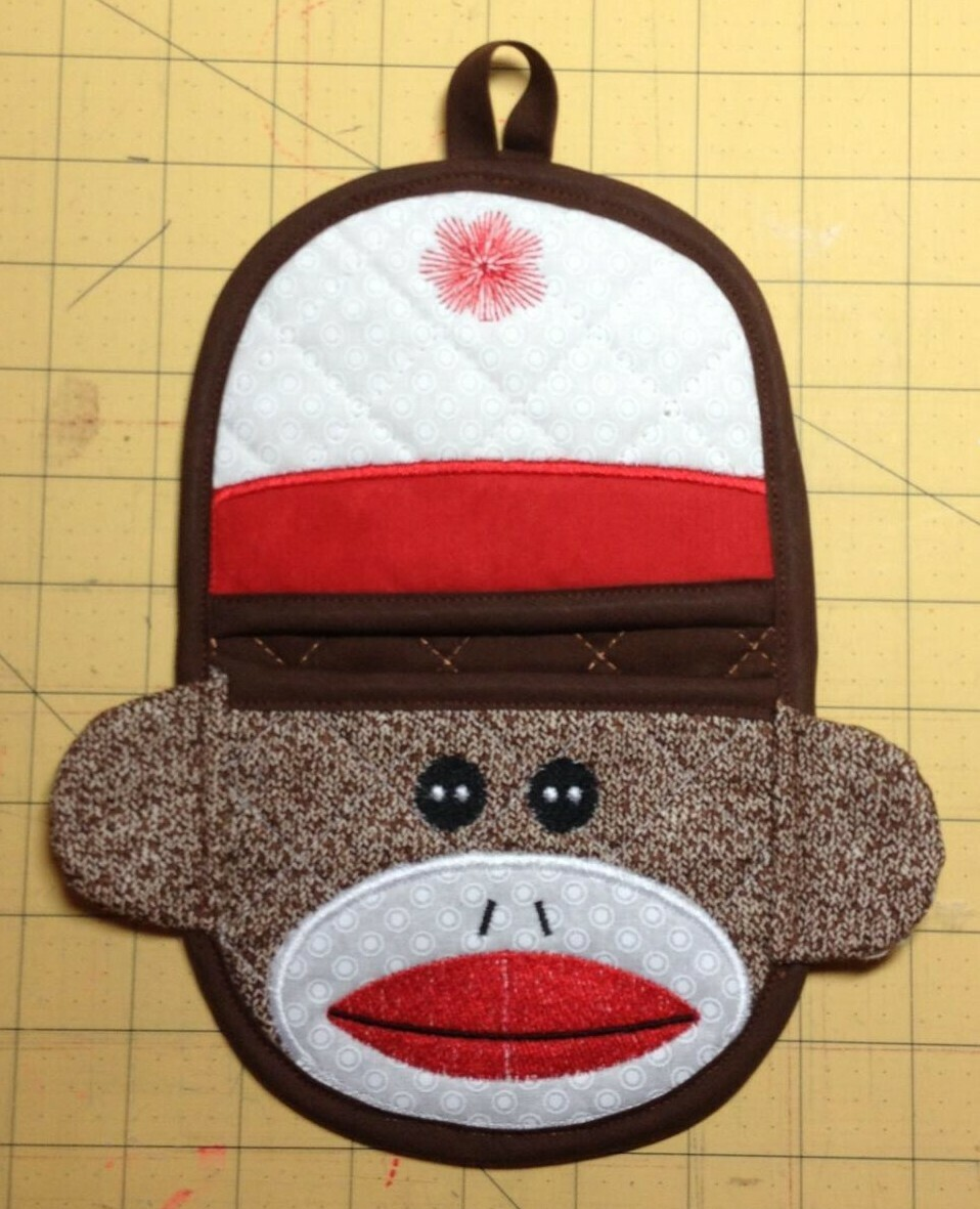 Sock Monkey oven mitt machine embroidery in the hoop design