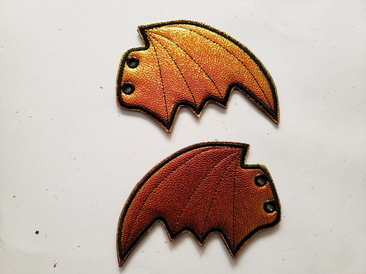 Bat skate wings in orange metallic shift
