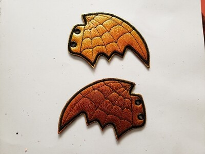 Bat skate wings in orange metallic shift with spiderweb stitching