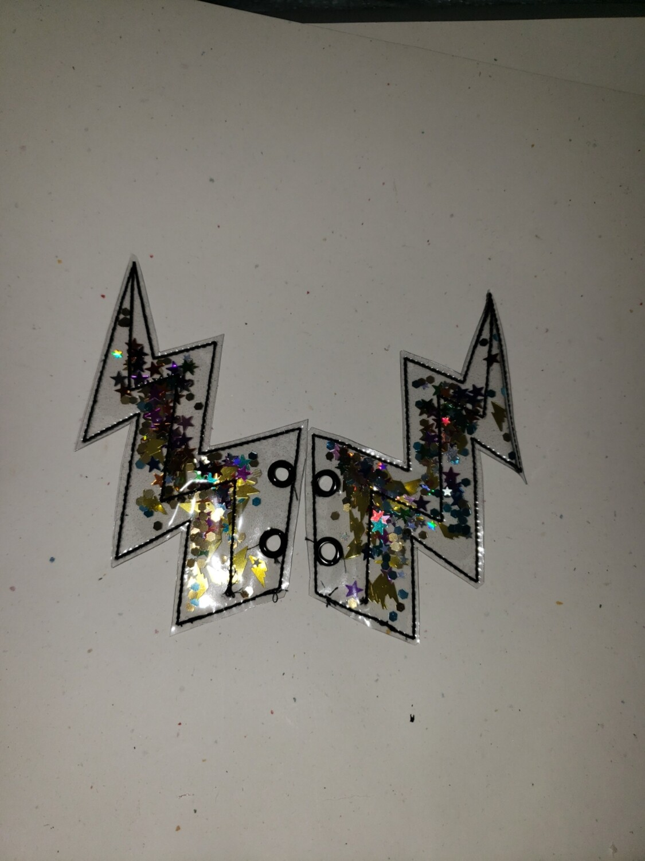 Transparent Lightning bolt shoe wings with glitter shapes inside