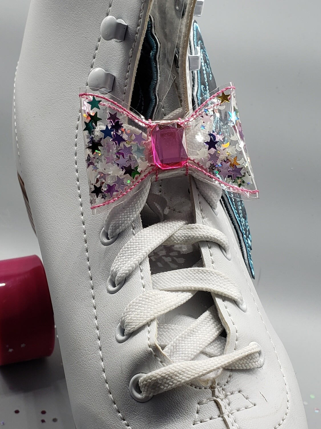 Transparent bows with glitter shapes inside