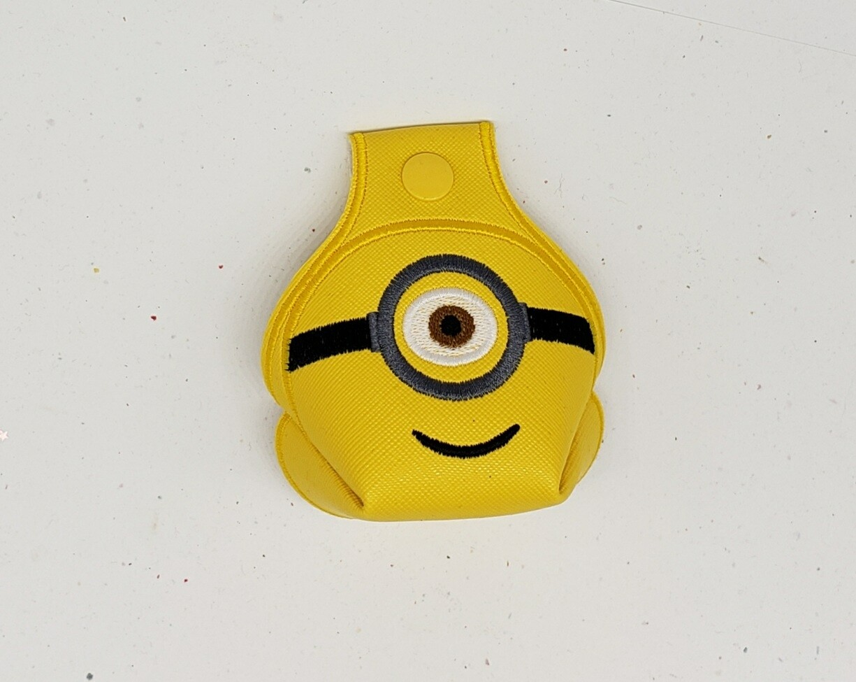 One eyed and two eyed minion set on yellow faux leather RTS