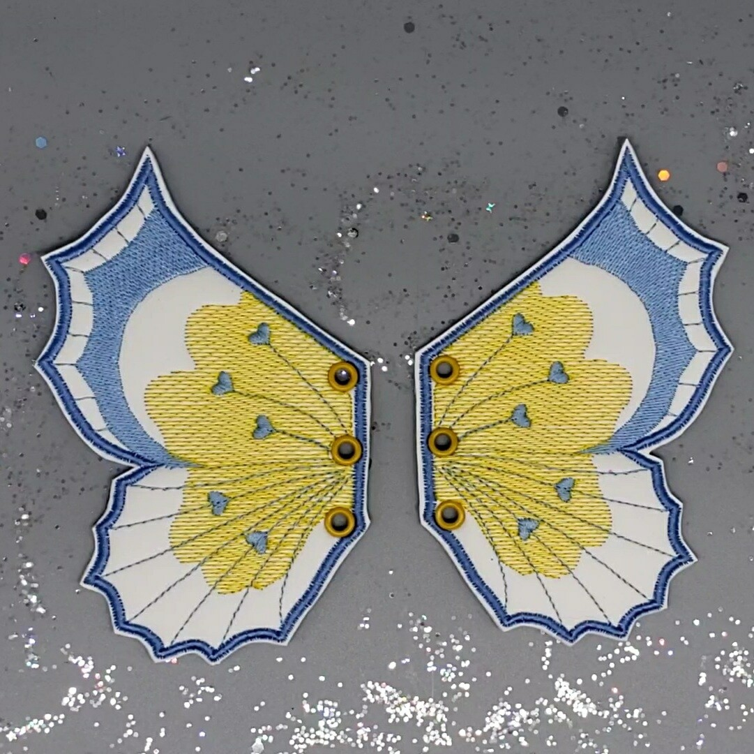 Butterfly skate wings yellow/blue on blur uv changing faux leather