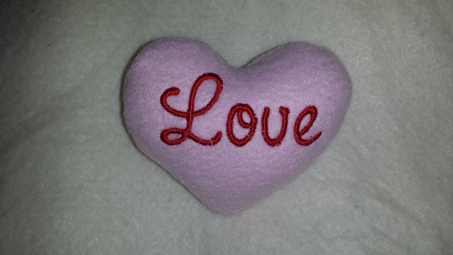Heart stuffie in the hoop embroidery design