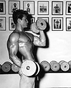 Dumbbell Curls at Ed's Gym