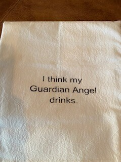 """I think my guardian angel drinks"" tea towel"