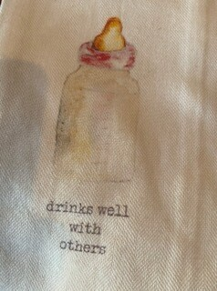 """""""Drinks well with others"""" baby girl bottle towel"""