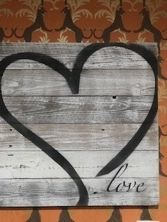 Love heart sign on distress wood