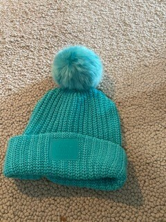 Turquoise Love your melon hat with matching pom.