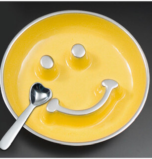 Yellow smiley dish with heart spoon