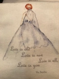 """love is old, love is new, love is all, love is you"" tea towel"