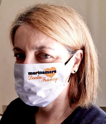 Mascherina con logo  aziendale ricamato e  personalizzato.