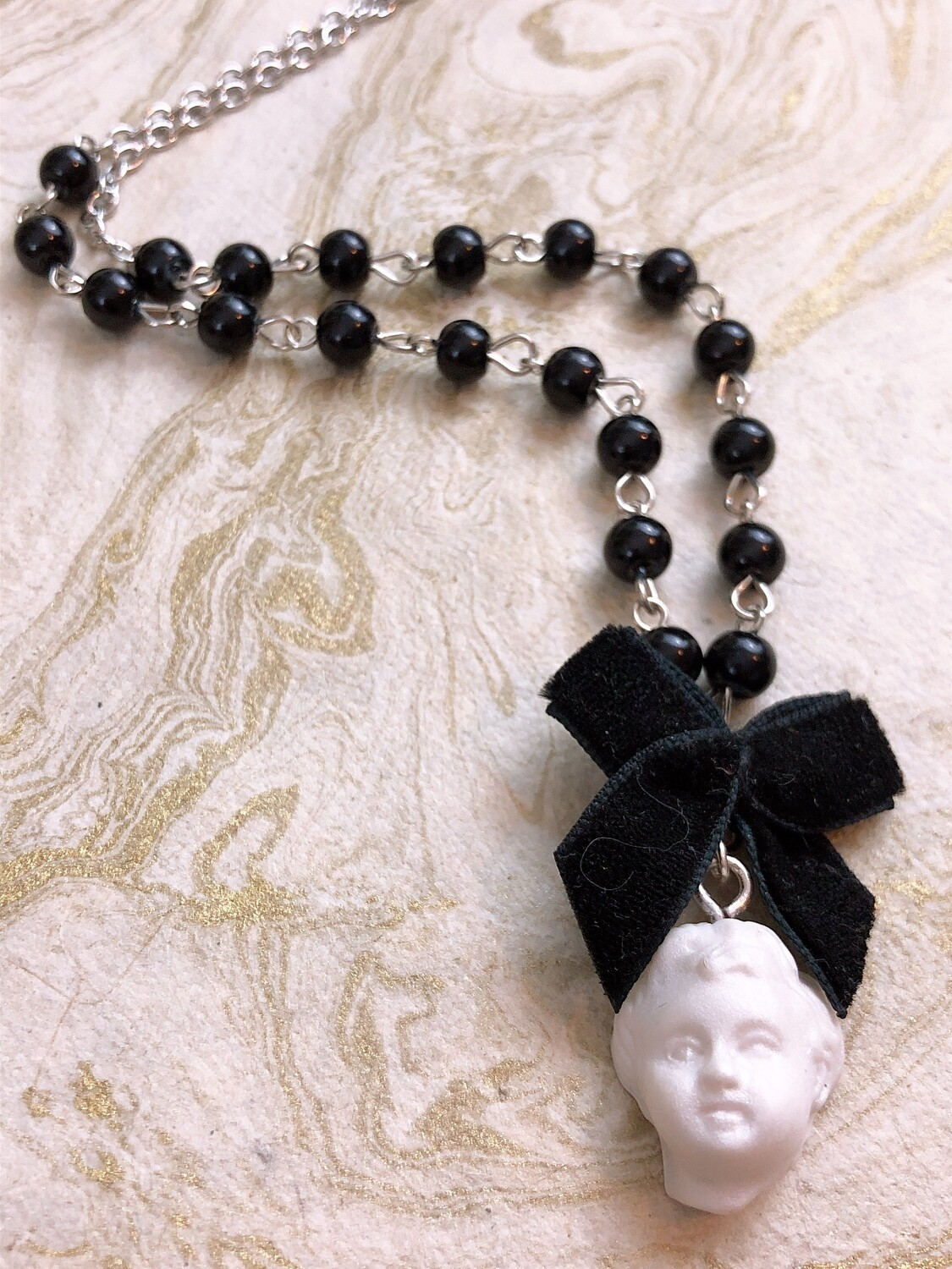 doll parts necklace (head)