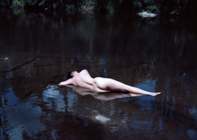 Woman in the river, Australia