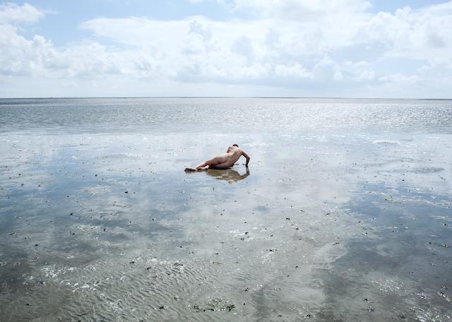 Woman in Wadden Sea, Denmark