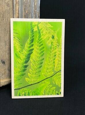 Puulle painettu kortti; lehdet