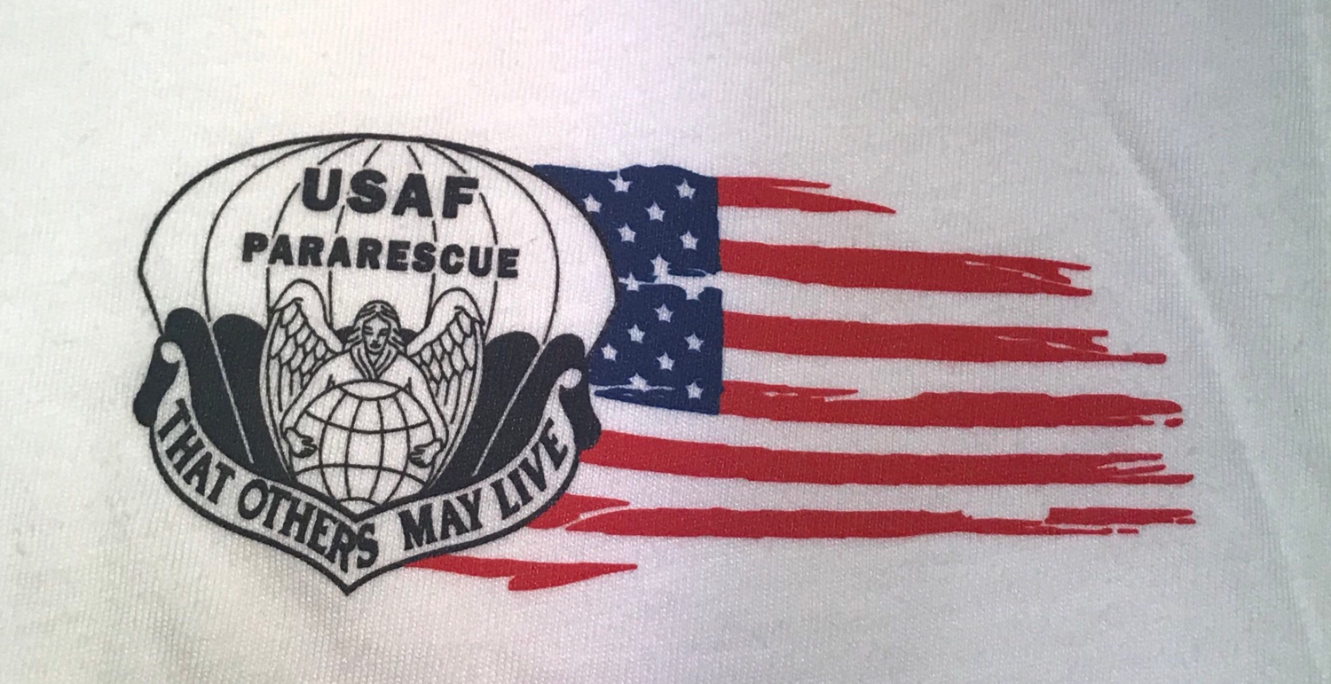 "pja/ T-Shirt White with ParaRescue Flash and Tattered Flag left chest. PJ Association ""Guardian Angel"" on back"
